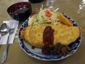 an omelet containing fried rice.jpg